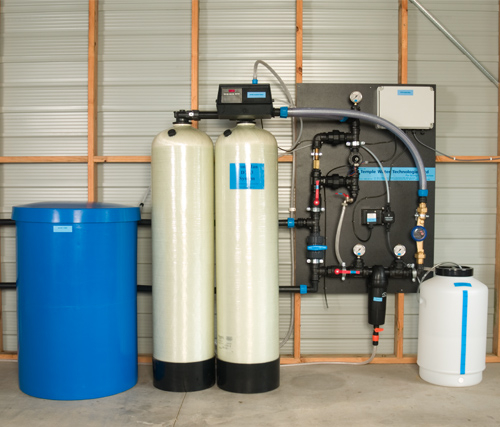 Automatic dual tank iron/manganese water treatment system
