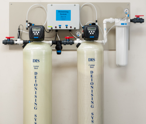 Deionising water treatment system